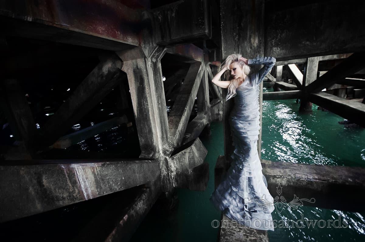 Mermaid wedding dress under pier