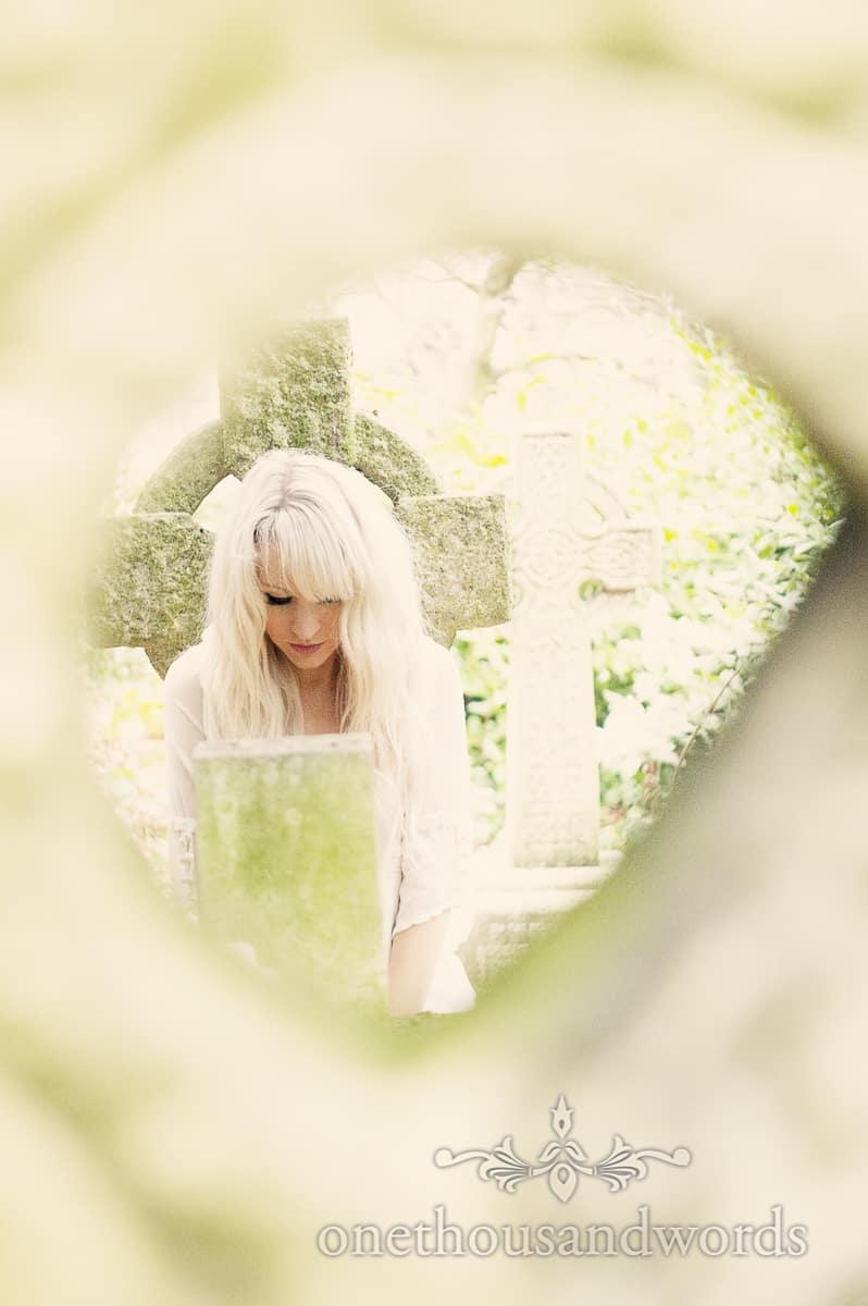 Bride in wedding dress on graveyard