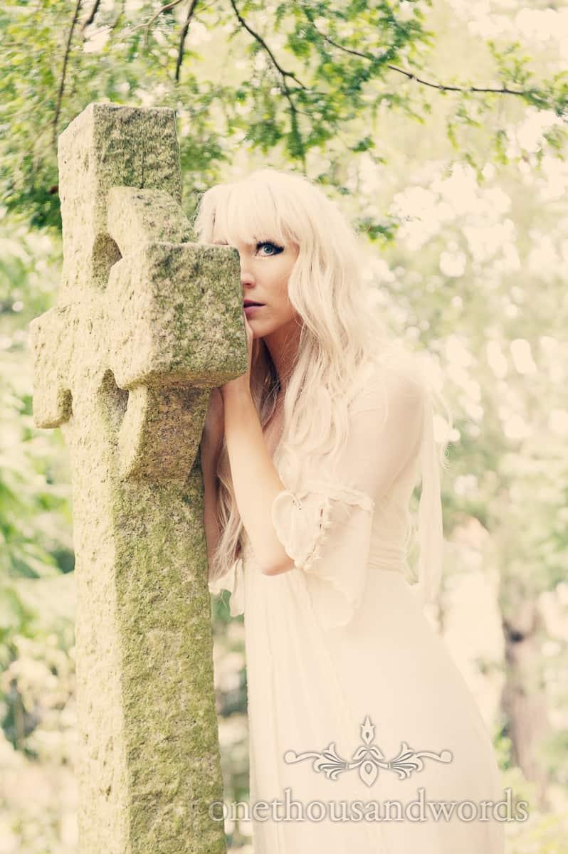 Weddign dress photographs in graveyard