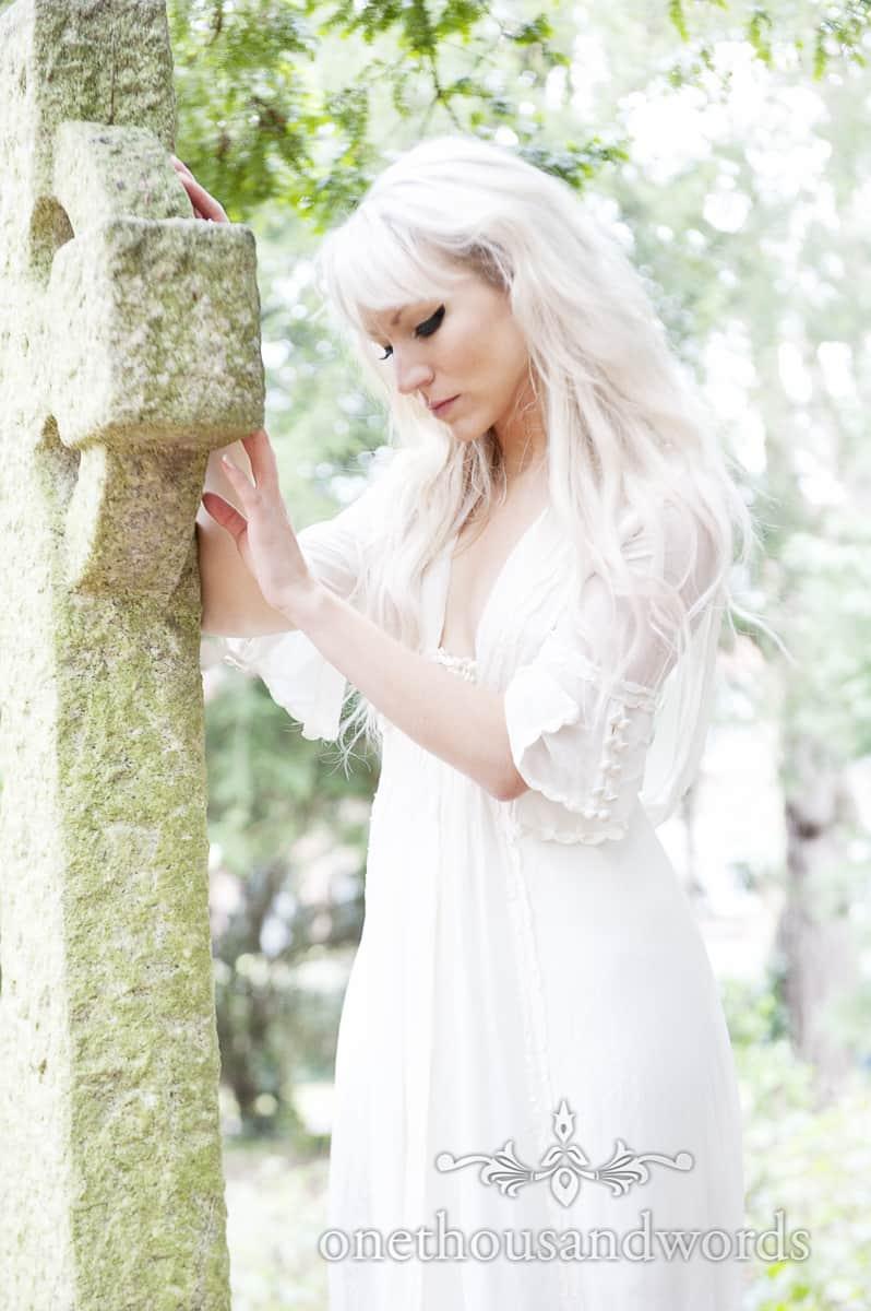 Wedding dress on bride in graveyard Bournemouth Wedding dress photographs