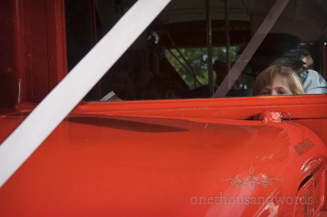 wedding guest red bus