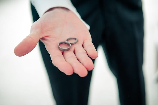 Black and white wedding photograph of of wedding rings