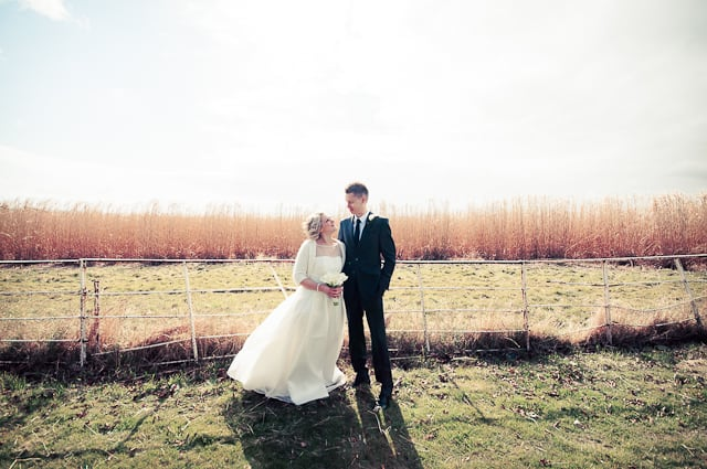Bride and Groom photograph with corn field