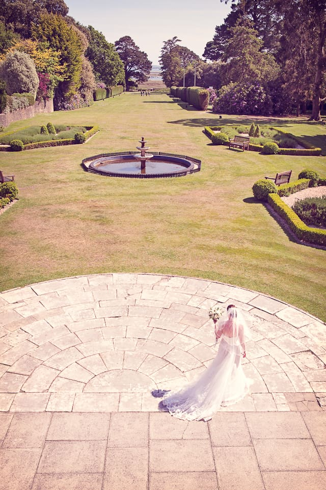bride in the gardens at Elmers Court Hotel wedding venue