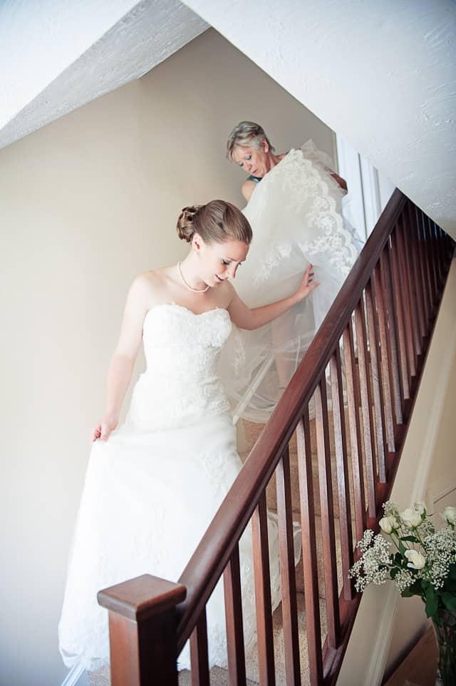 bride decends stairs in her wedding dress