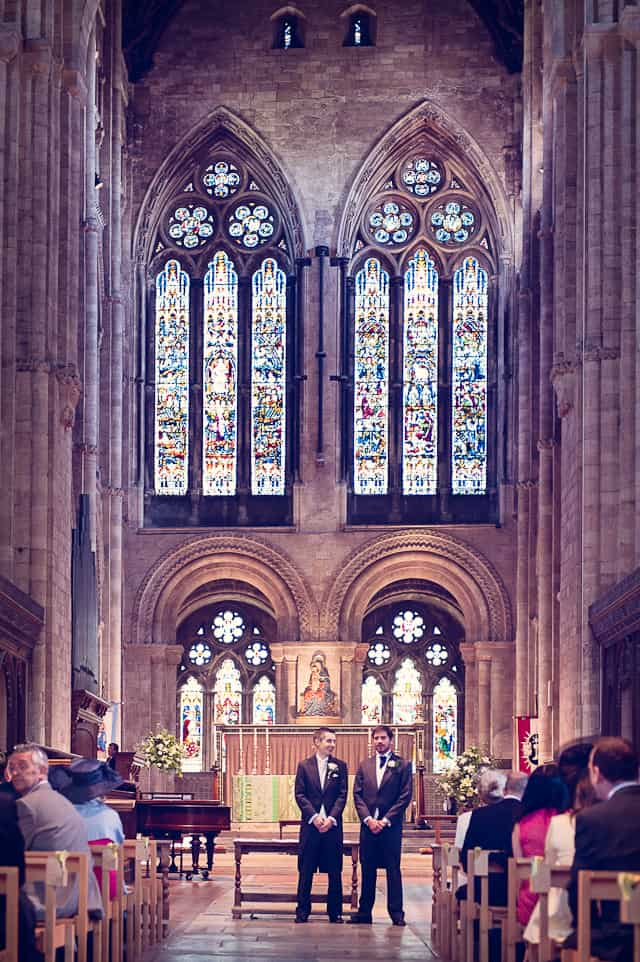 Groom and best man awaiting bride at Romsey Abbey wedding