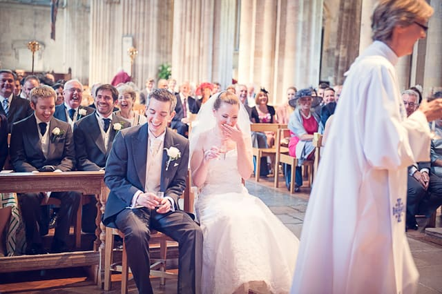 bride and groom laughing during wedding ceremony at Romsey Abbey