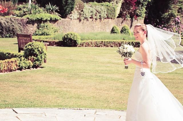 Bride in gardens at Elmer's Court Hotel, Lymington, New Forest