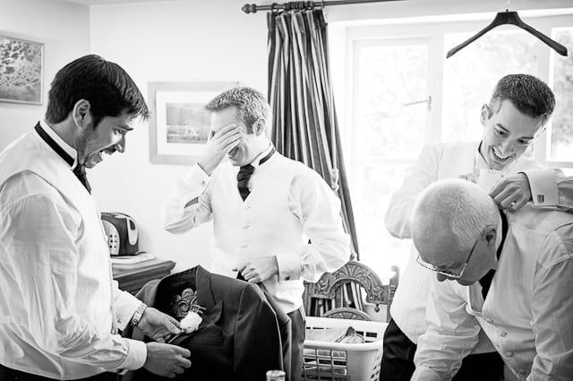 Black and White photograph of groomsmen on wedding morning