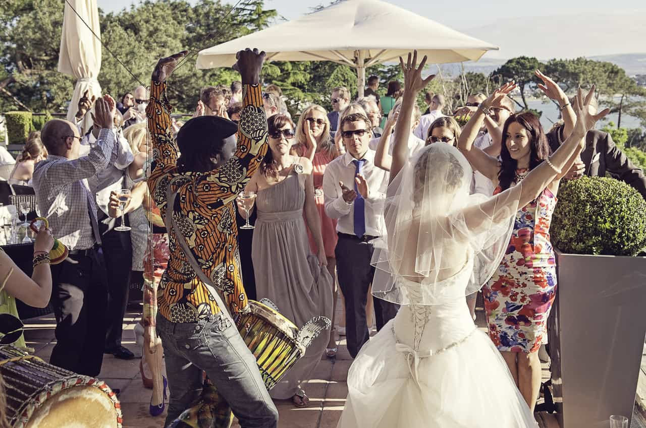 African drummer and bride at Poole wedding venue