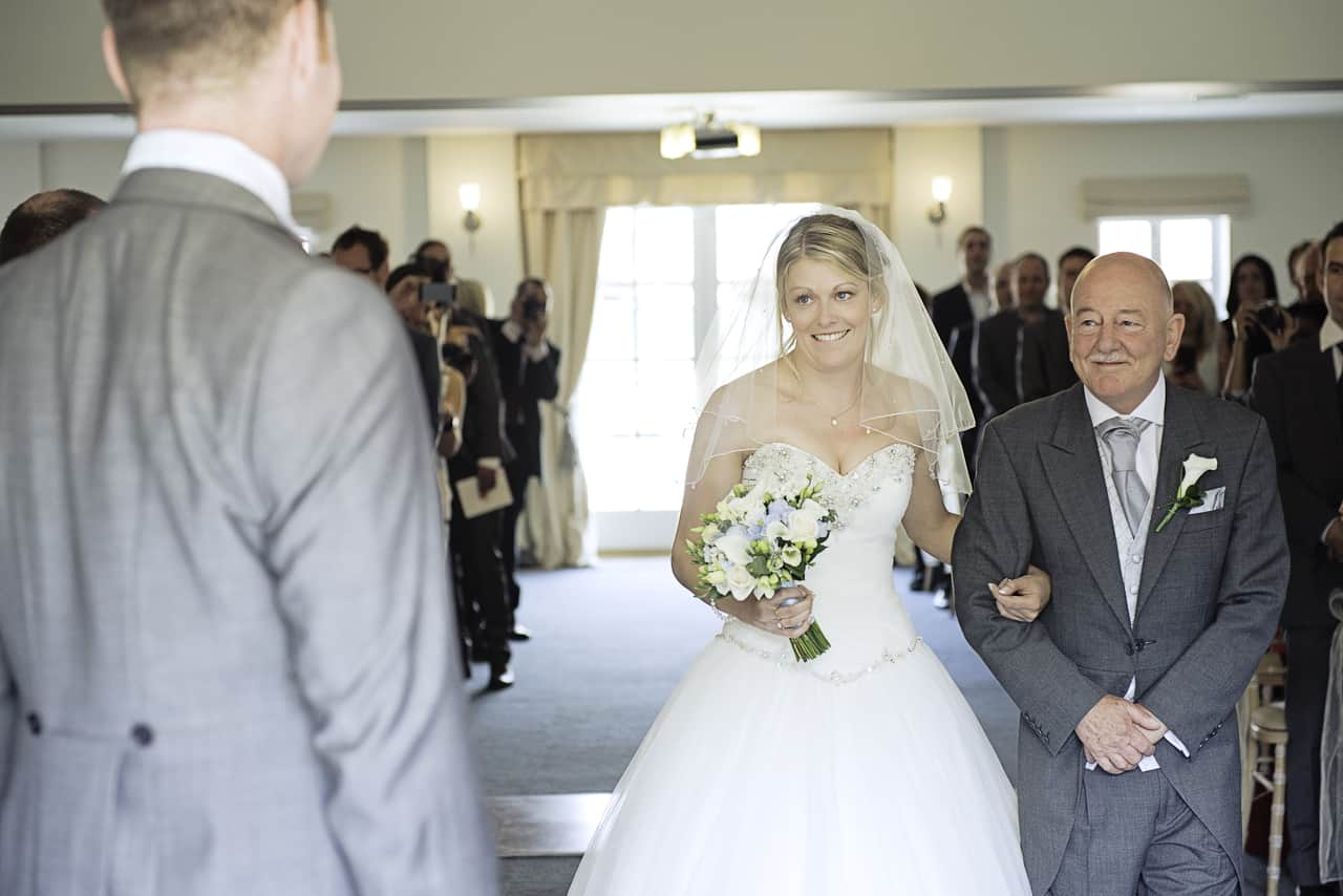 Bride and her father walk down the aisle at The Italian Villa wedding venue Dorset
