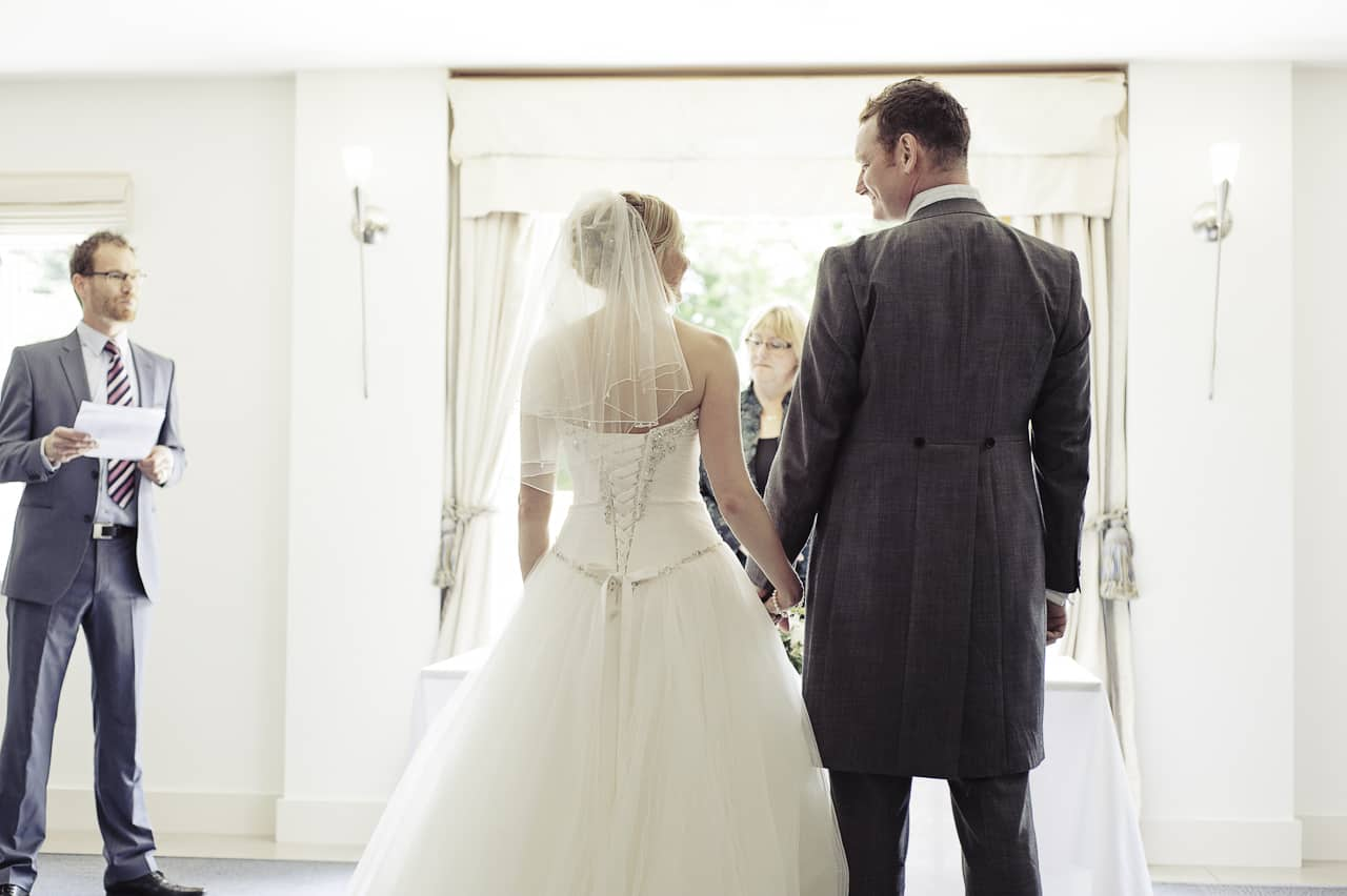 Bride and groom during civil wedding ceremony at The Italian Villa Dorset
