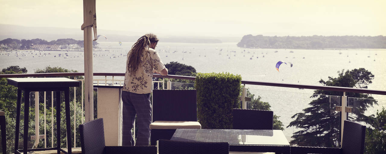 wedding guest with view of Poole Harbour at Harbour Heights Hotel Dorset