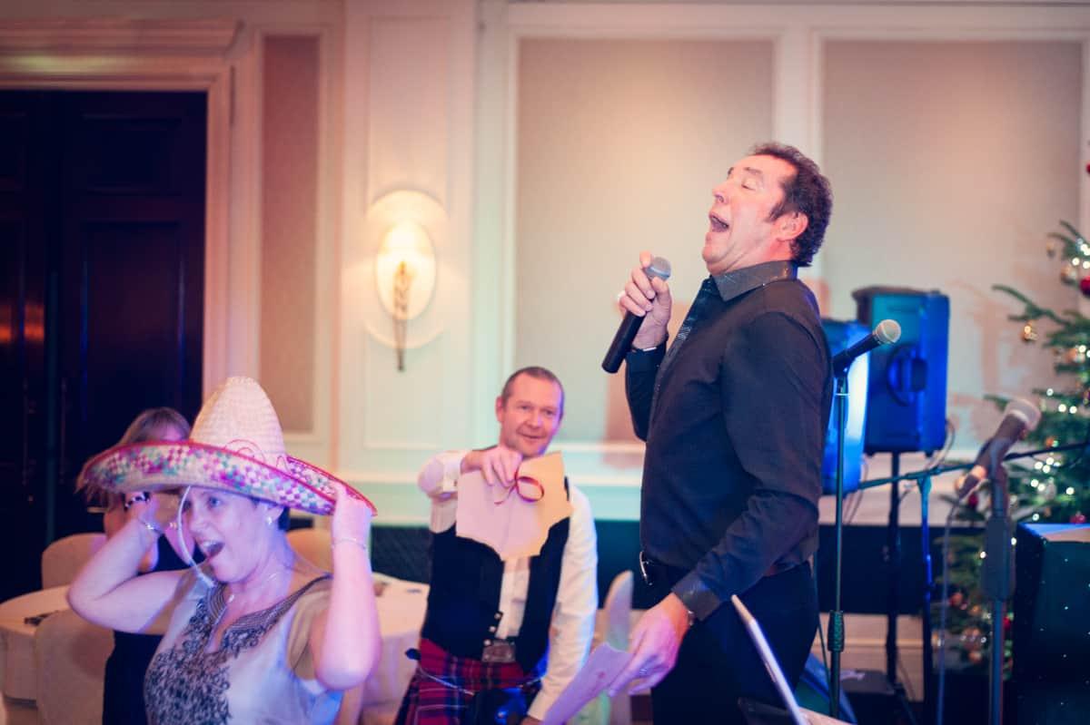 Wedding photography of Tom Jones singing at Four Seasons hotel wedding venue in Hampshire