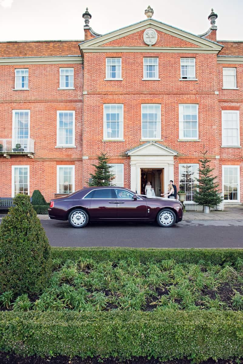 Wedding photographer in Hampshire wedding car at Four Seasons Hotel