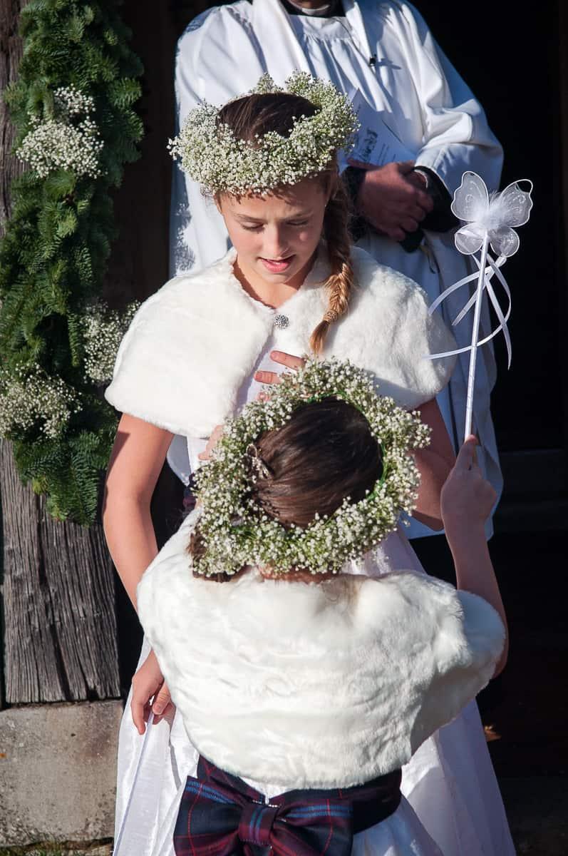 Flower girls in white at church wedding venue
