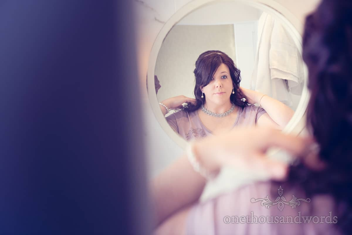 wedding photography of bridal preperations at Christchurch Harbour Hotel