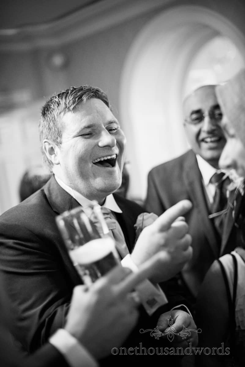 Black and White photograph of groom at Christchurch Harbour Hotel