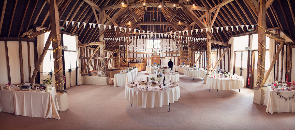 Clock barn wedding tables and bunting