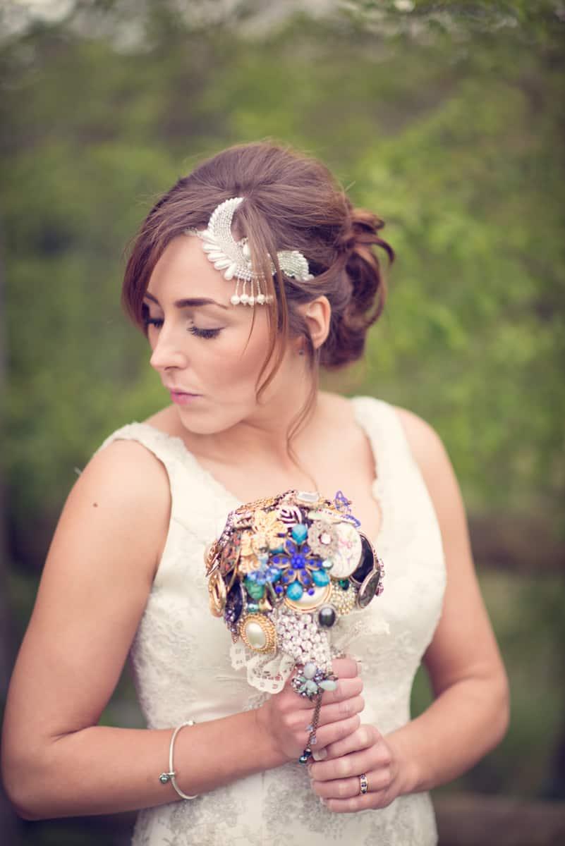 bride with broach boquet at clock barn