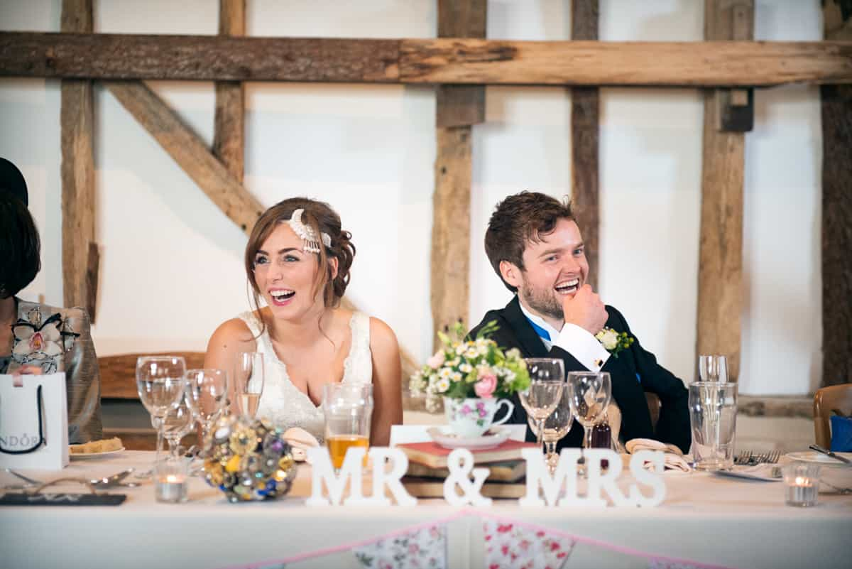 Bride and Groom during speeches at Clock Barn