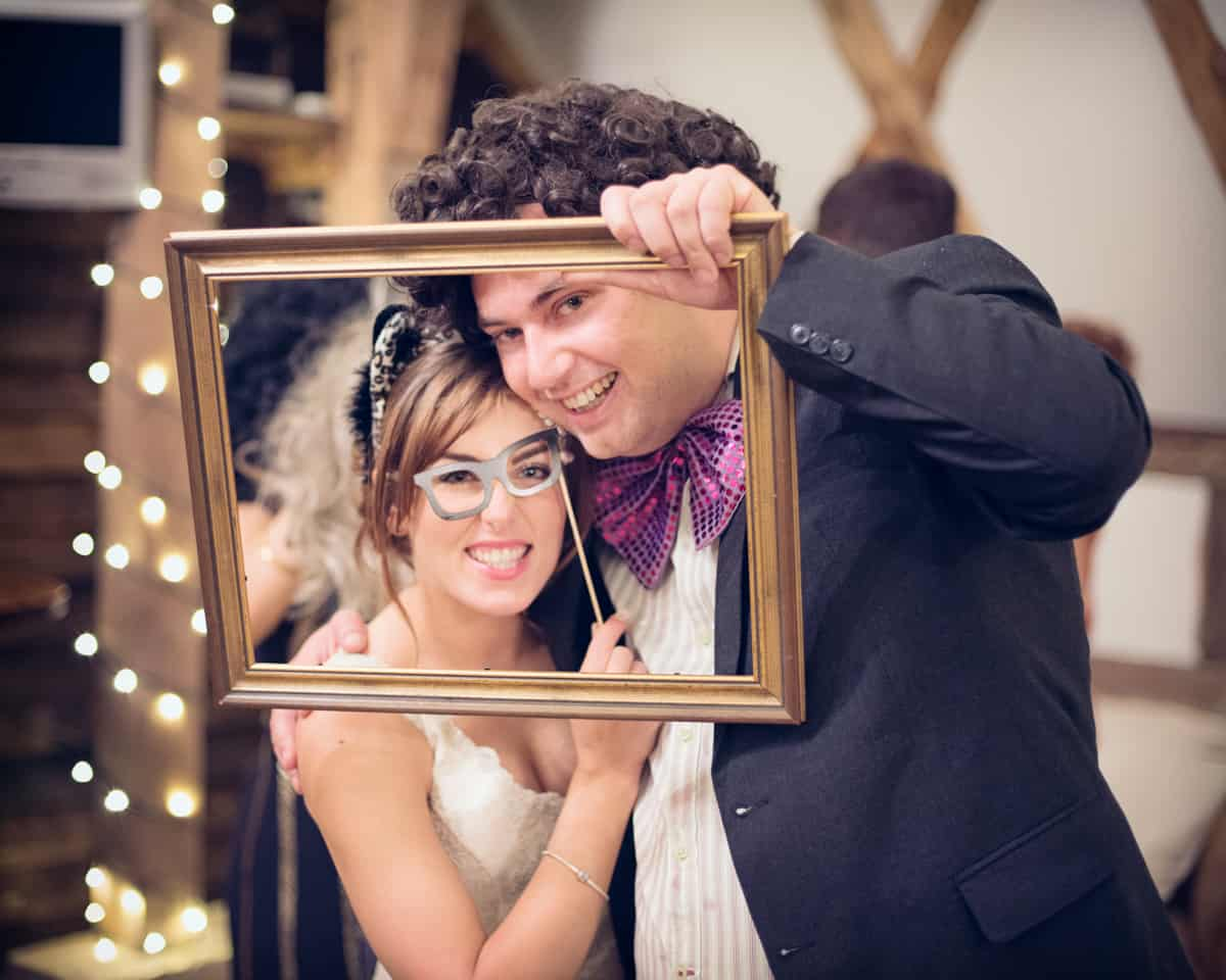 wedding guests with costumes and picture frames