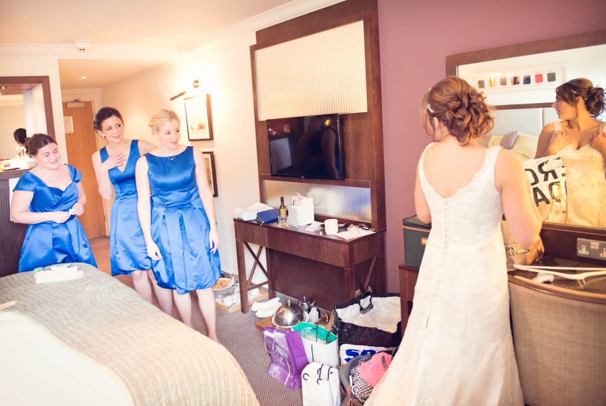 Bride and bridesmaids on bed at bride in morning at Norton Hotel Park