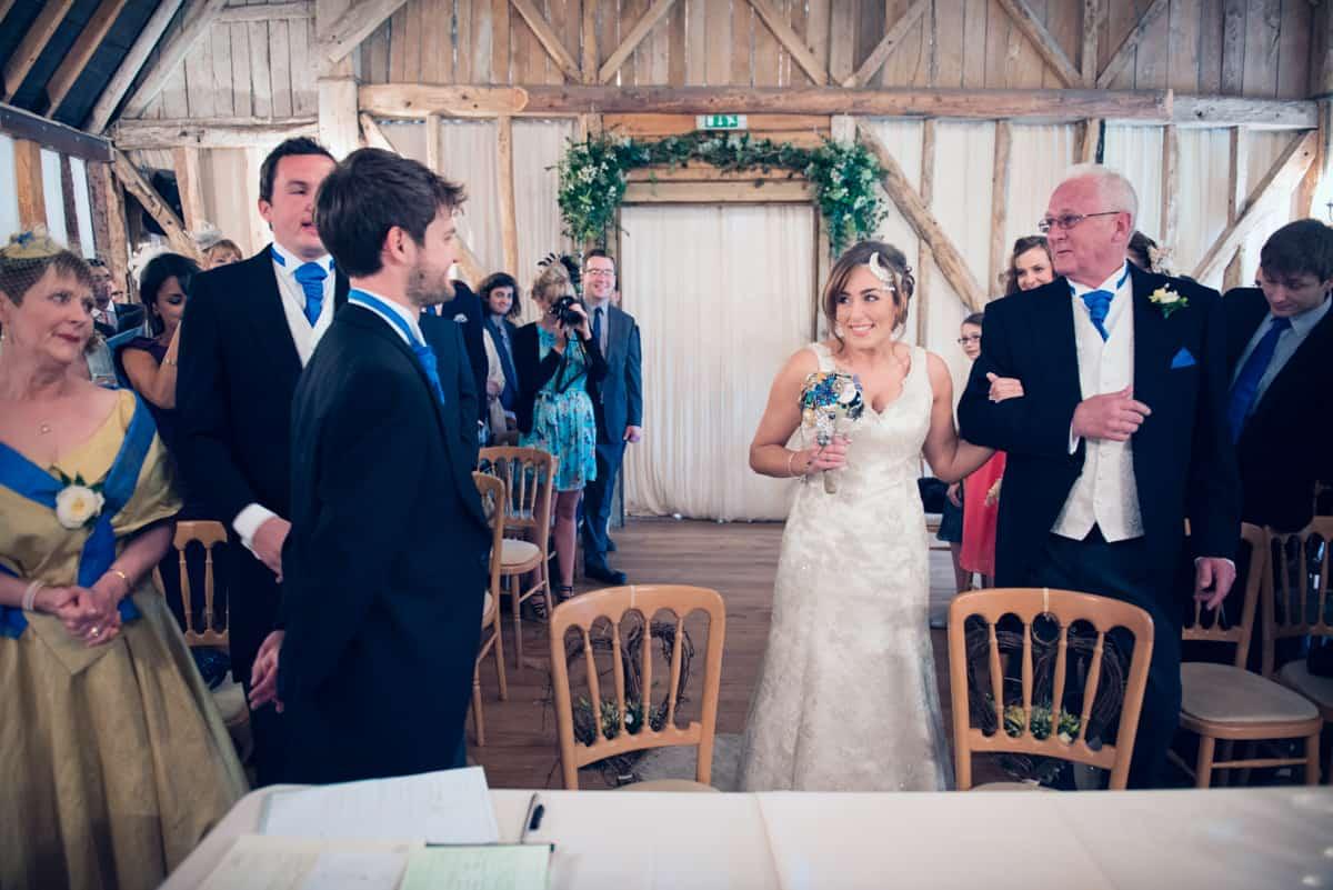 Bride walks down the aisle at Clock Barn