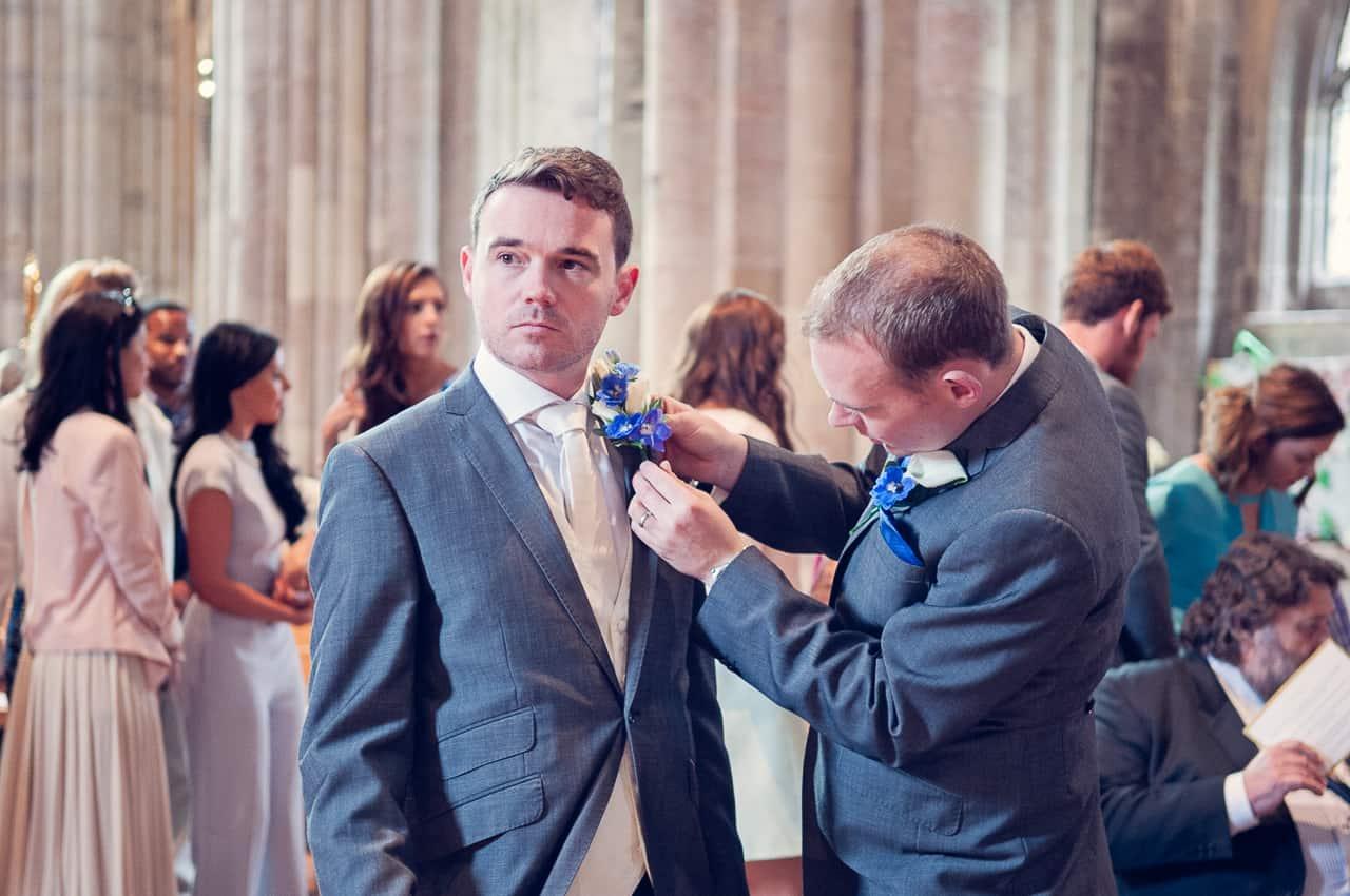 Grooms buttonhole in Romsey Abbey wedding venue