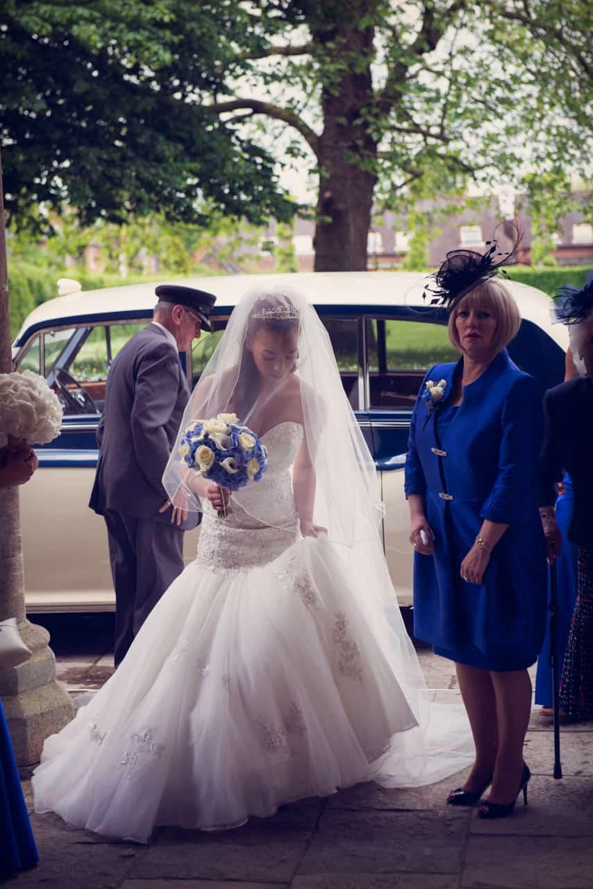 Bride and Royal wedding car at Romsey Abbey wedding