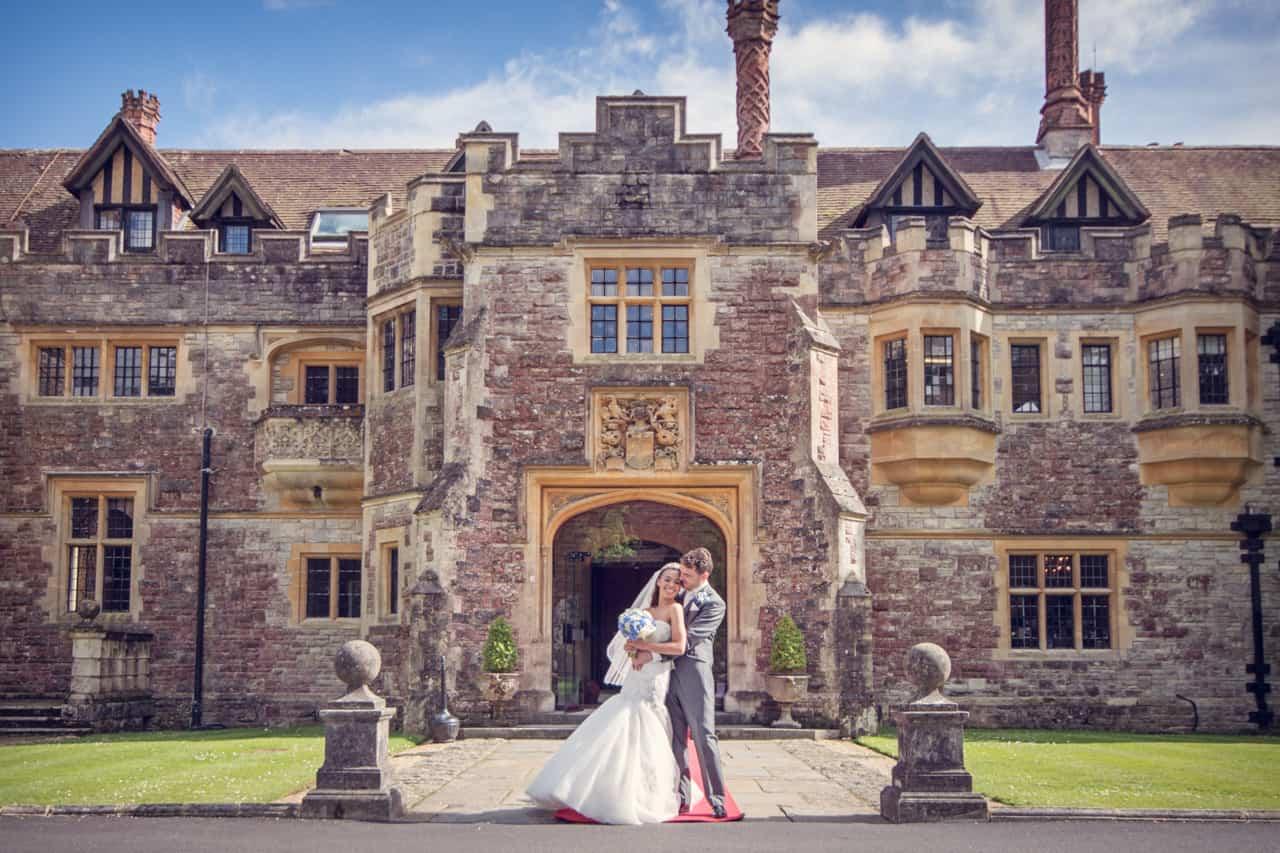 Bride and groom outside Rhinefield House wedding venue