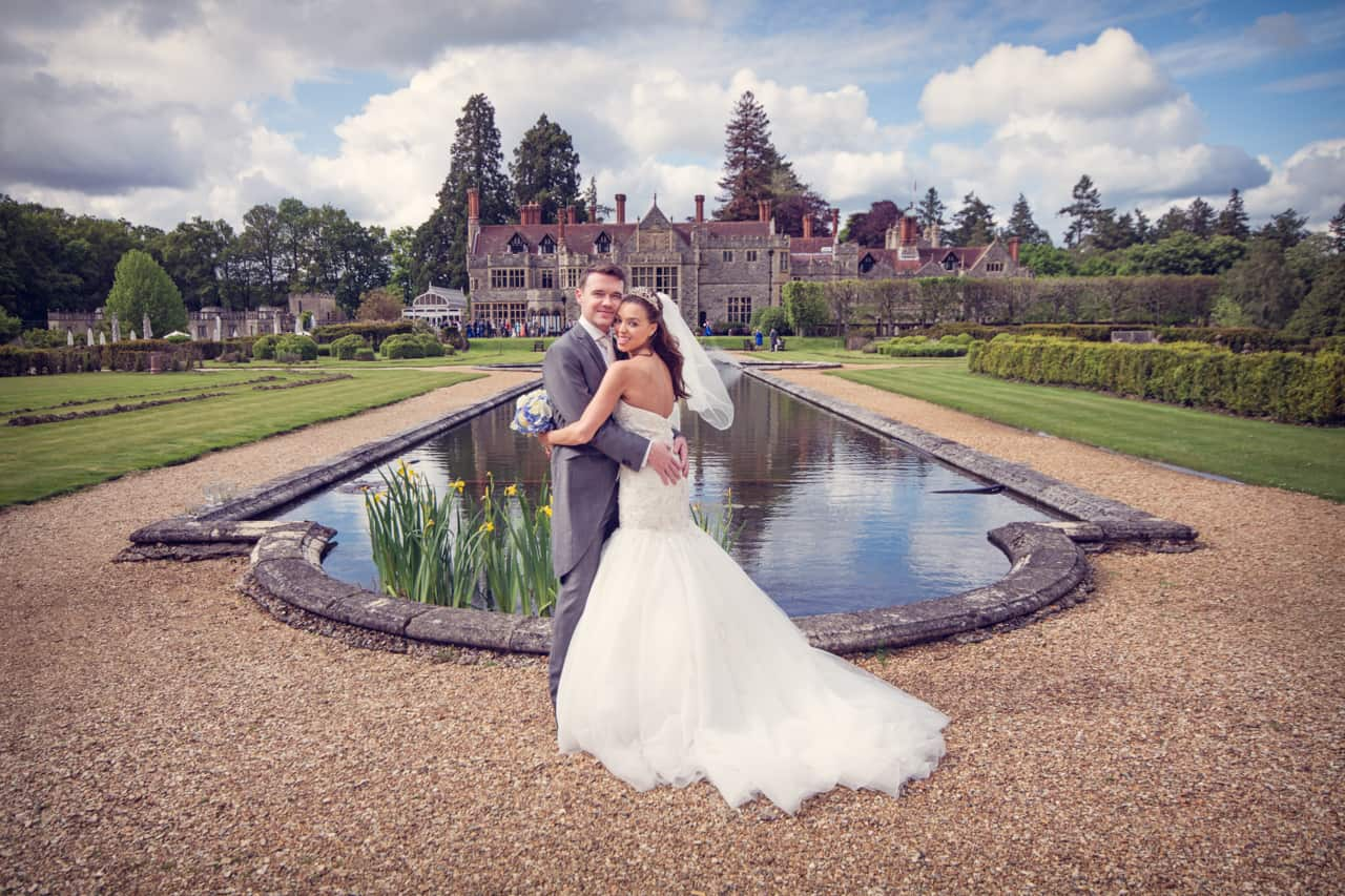 Bride and groom in Rhinefield House Hotel Gardens