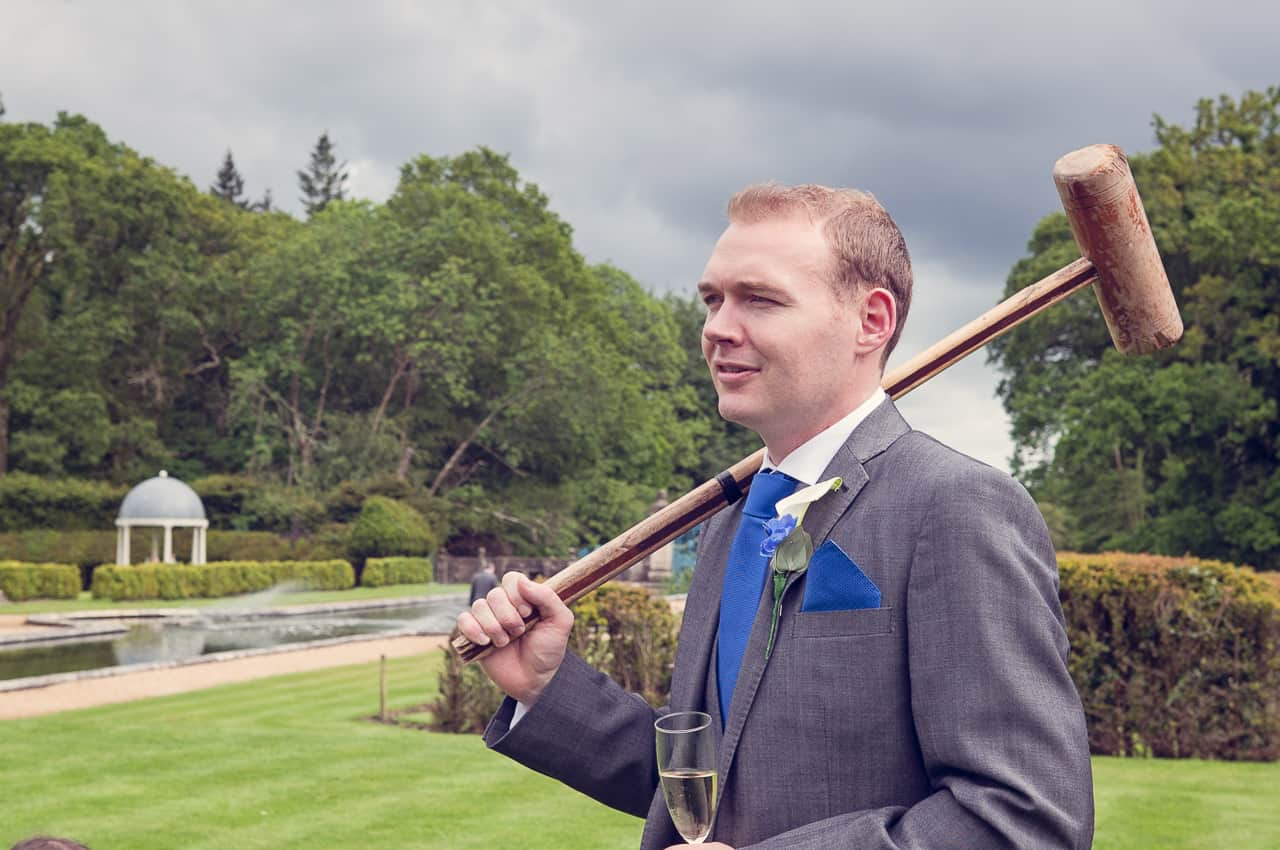 Best man with croquet clubs at Rhinefield Houlse Hote