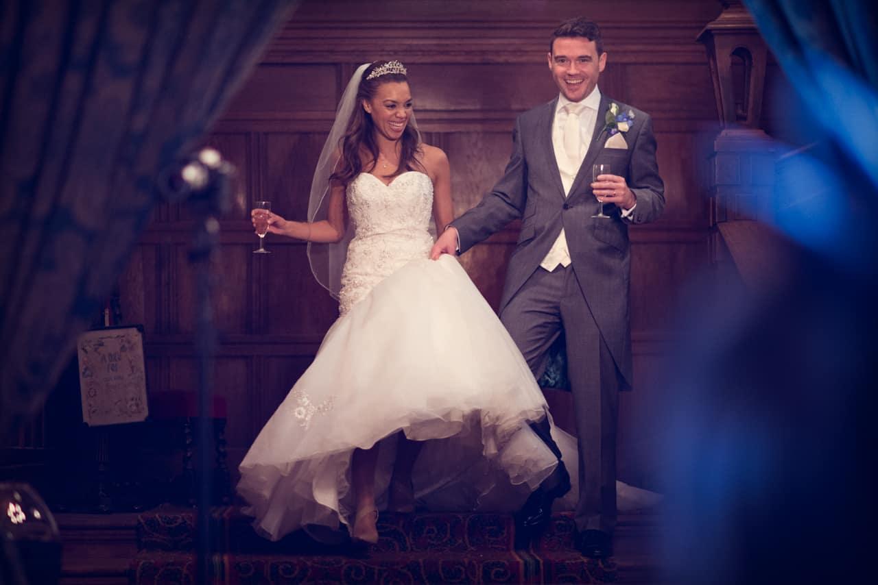 Bride and Groom enter wedding breakfast at Rhinefield House Hotel, wedding venue in Hampshire