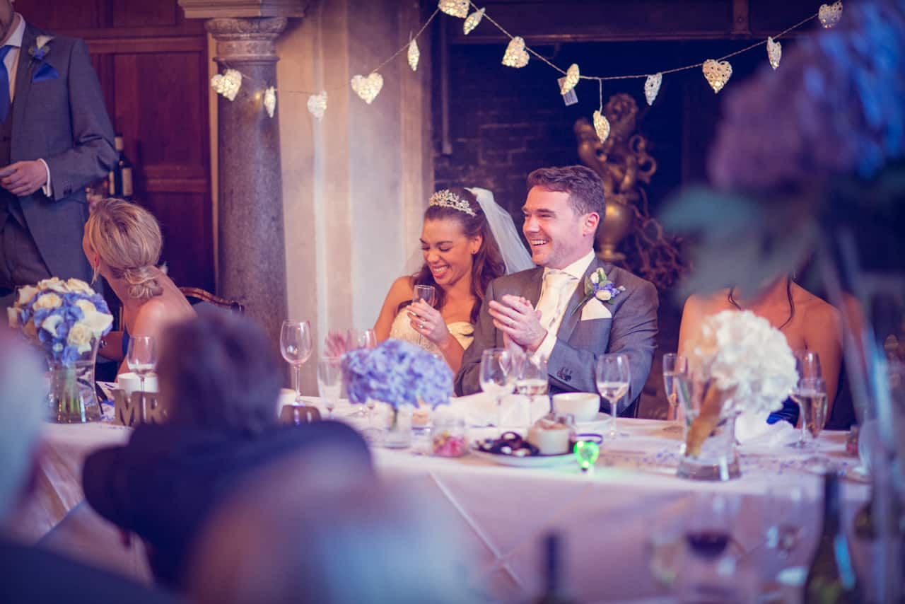 Bride and groom during speeches at Rhinefield House wedding