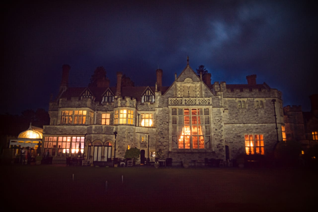 Rhinefield House wedding venue at night