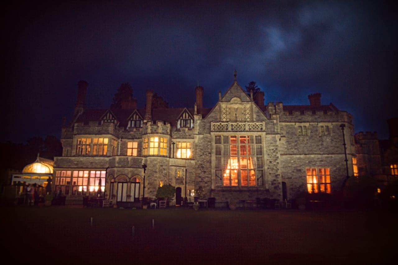 Rhinefield House wedding venue at night