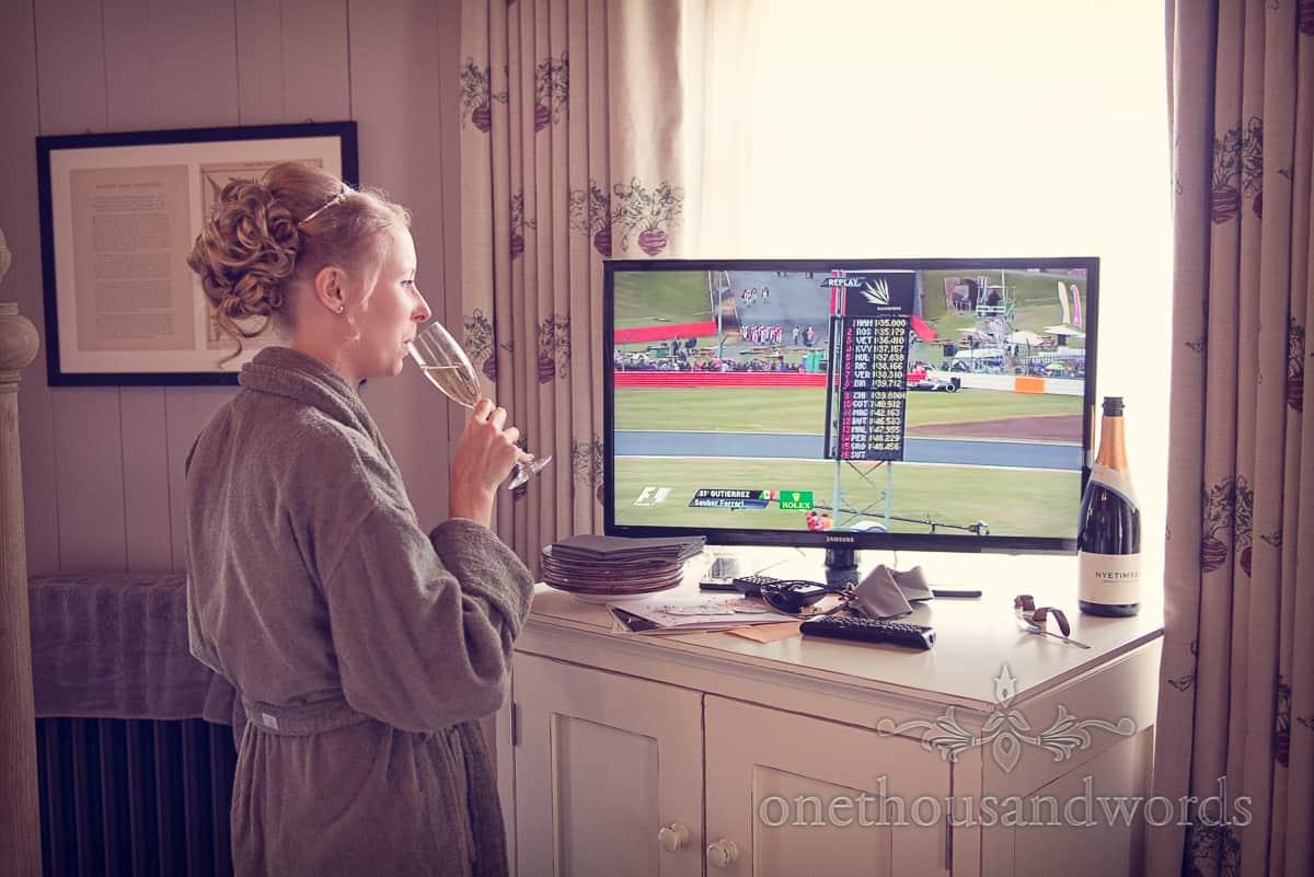 Bride watching grand prix on wedding morning