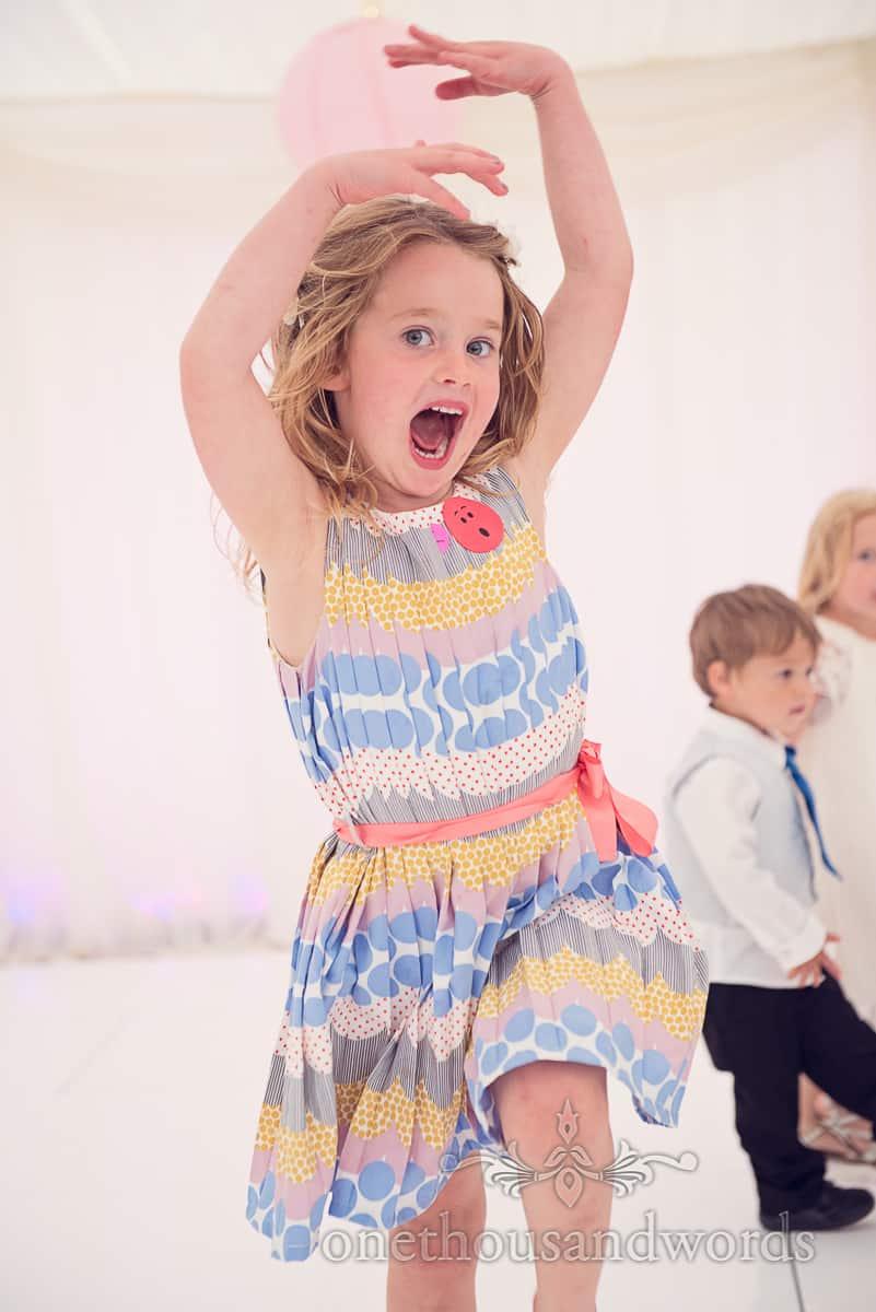 child dancing at wedding