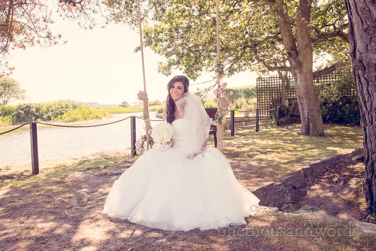 Bride on swing at Christchurch Harbour Hotel