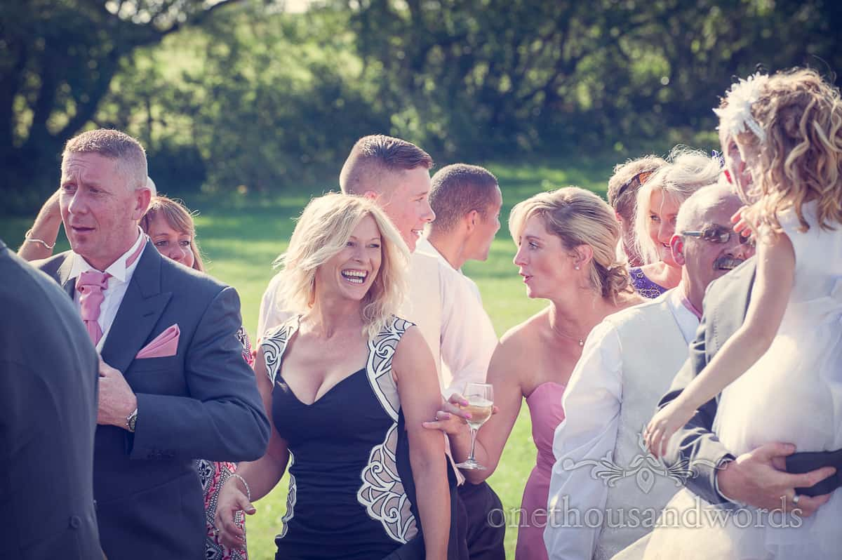 Wedding guests in group photograph at Harmans cross village hall