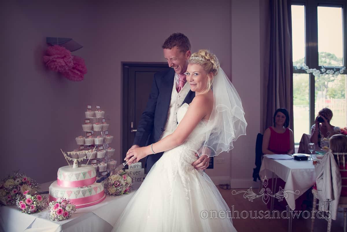 Harmans Cross Village Hall Wedding, cutting the cake