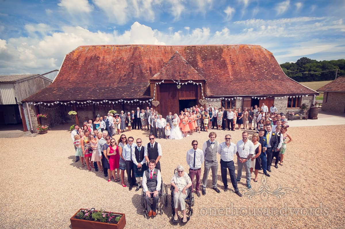 wedding love heart group photograph at Stockbridge Farm Barn