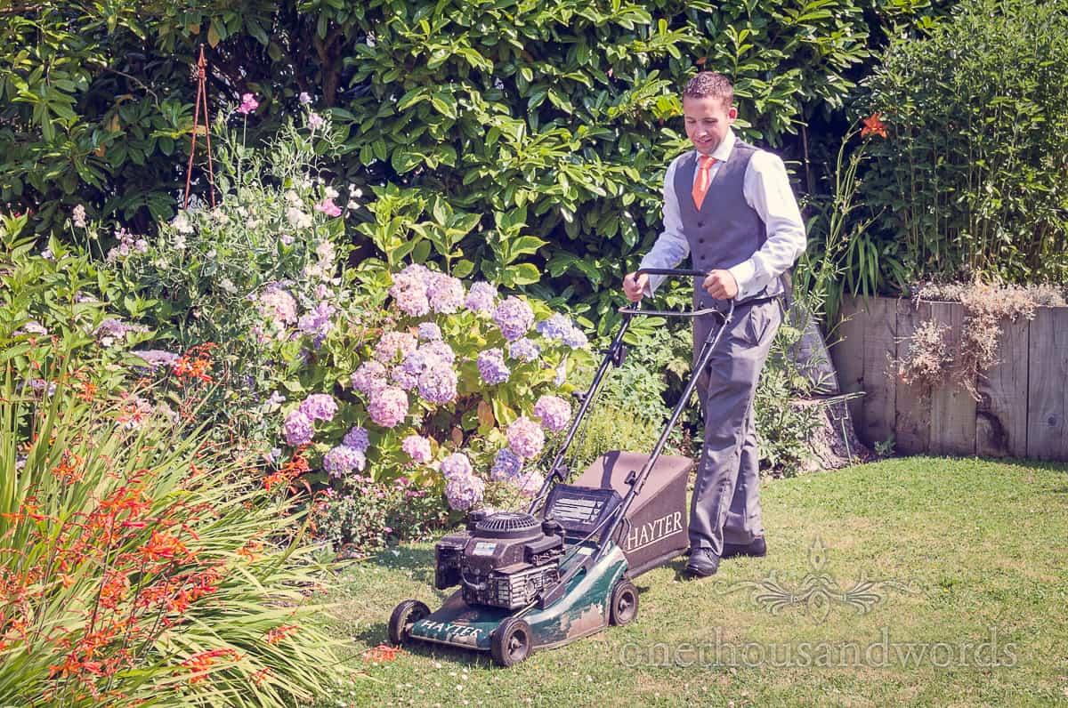 Groom mowing lawn on wedding morning