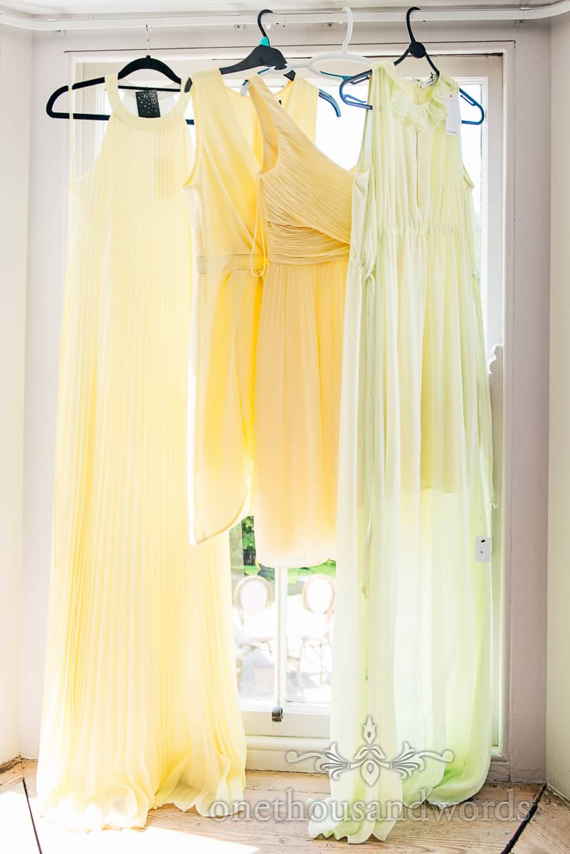 yellow lemon bridesmaids dresses hanging in window