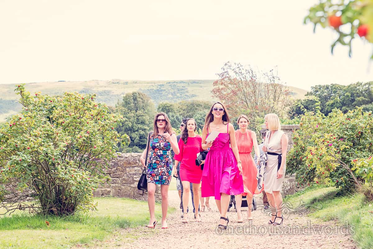 wedding guests arrive at Lulworth Castle Wedding service