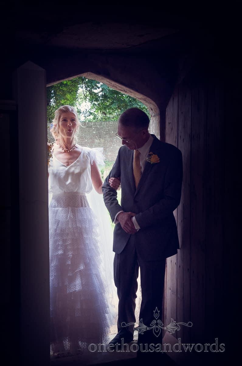 bride nervously enters church at Lulworth Castle Wedding