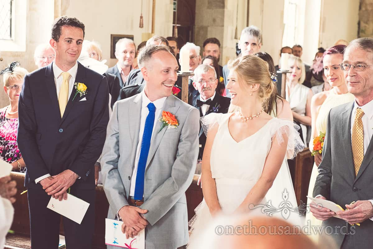 Bride and groom during Lulworth Castle Wedding service