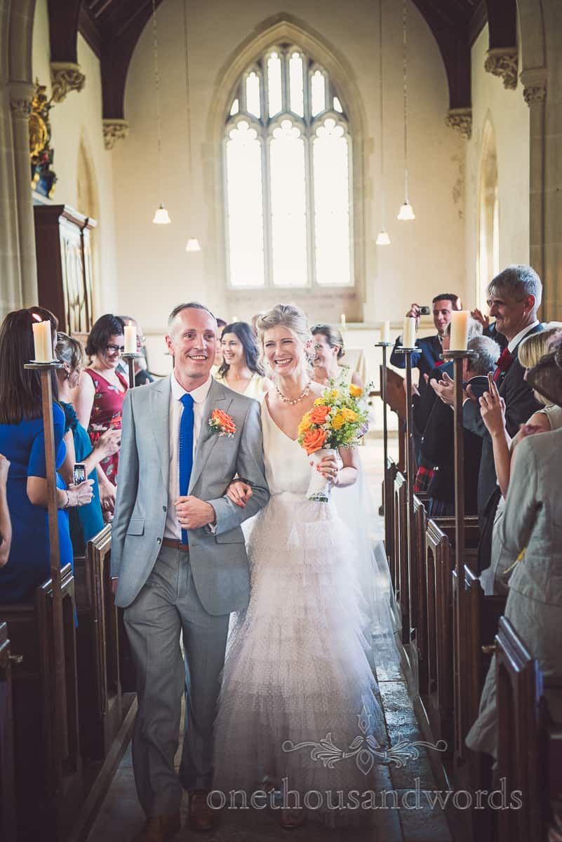 Walking down the aisle at Lulworth Castle Wedding