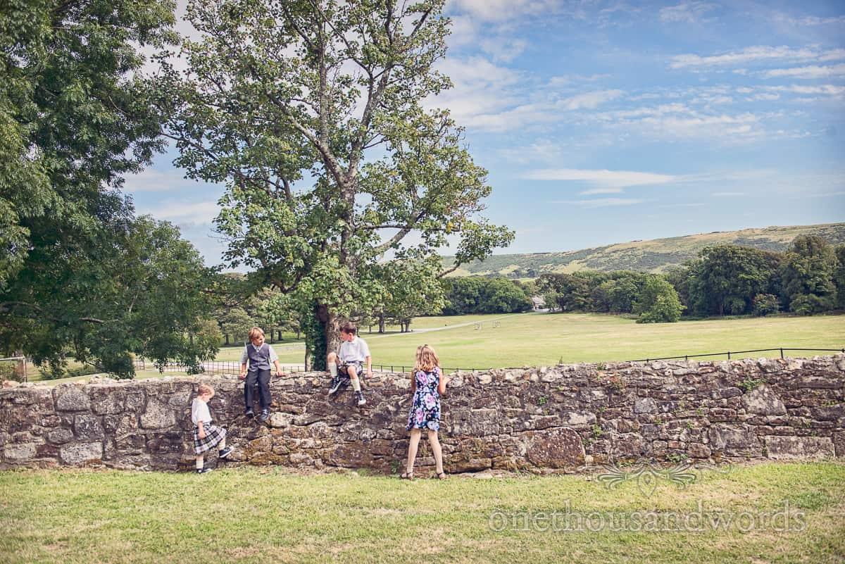 Children play at Lulworth Castle Wedding